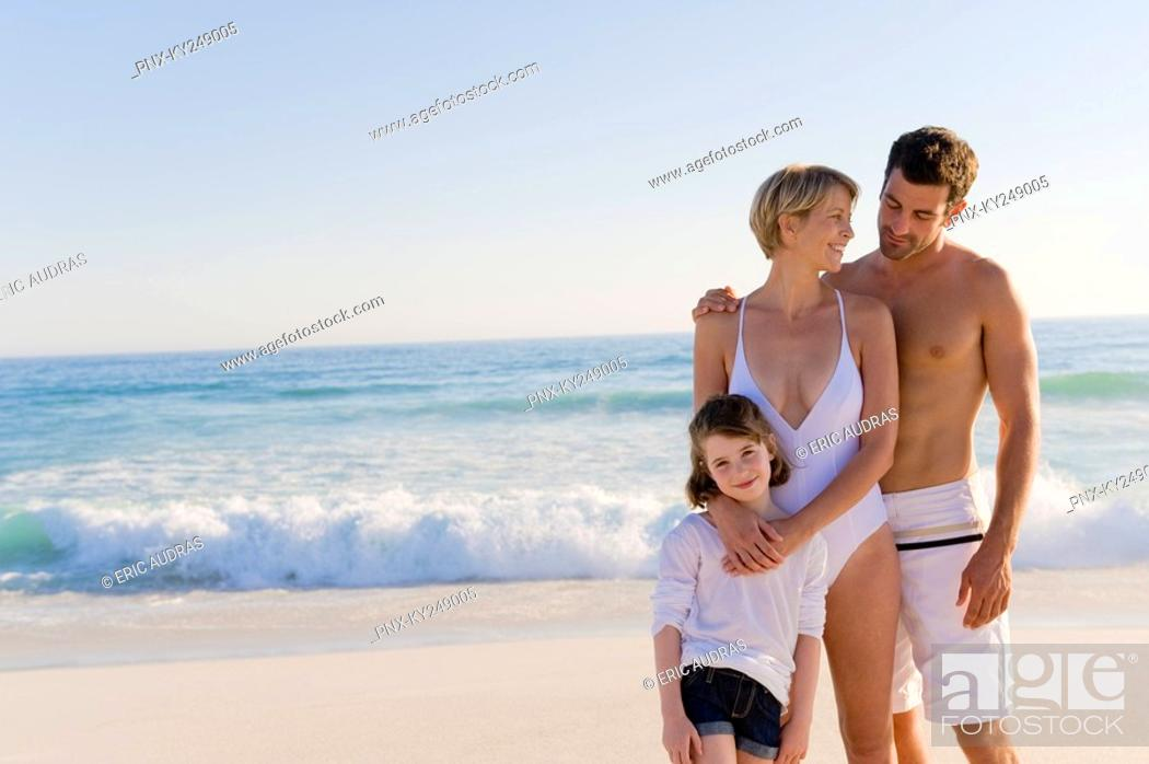 Stock Photo: Family standing on the beach.