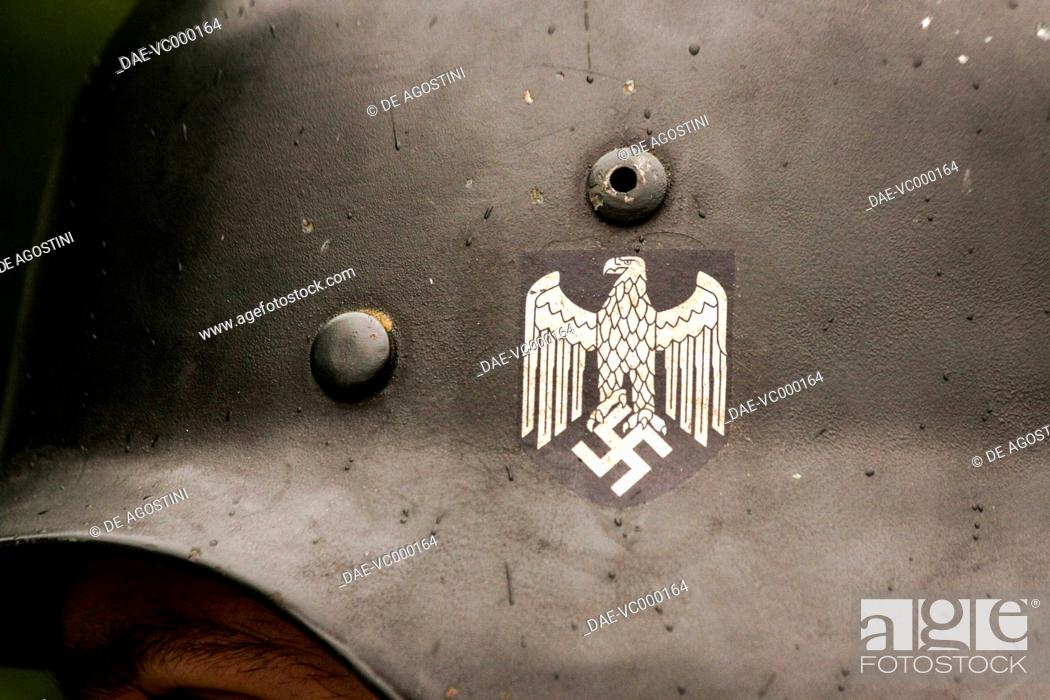 Eagle with swastika, detail from the helmet of a German soldier of