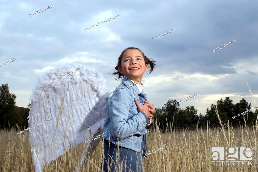 Stock Photo: Girl wearing angel wings.