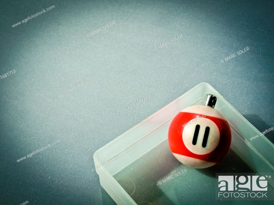 Stock Photo: Number 11, billiard ball in a little plastic box.