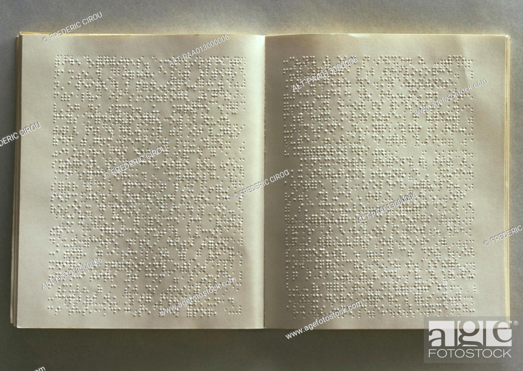 Stock Photo: Open book with brail on pages.