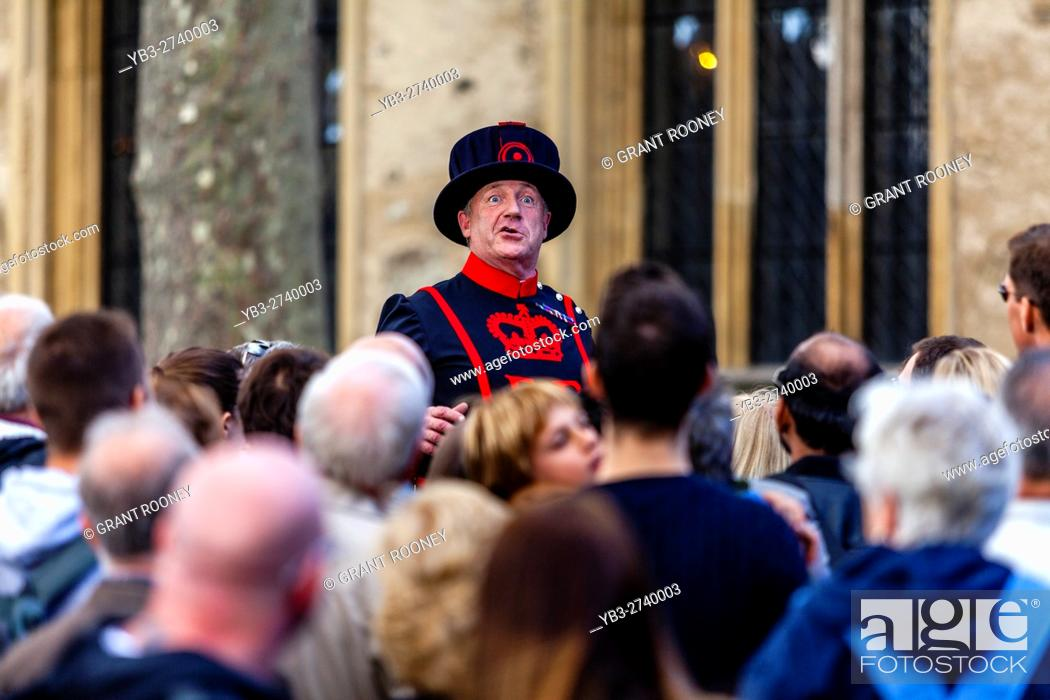 Stock Photo: A Beefeater (Yeoman of the Guard) Giving A Tour At The Tower Of London, London, England.