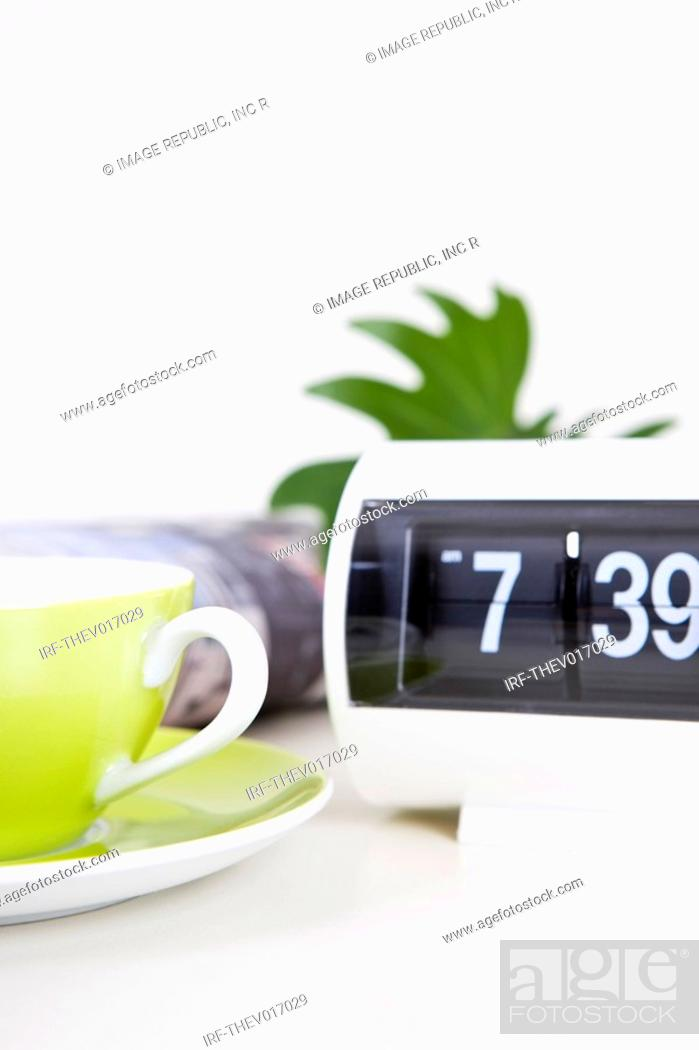 Stock Photo: coffee cup and clock.