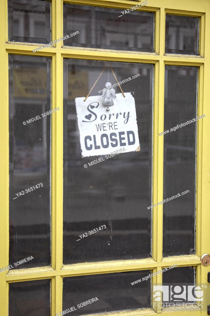 Stock Photo: Sorry We're closed Sign in Shop Doorway.
