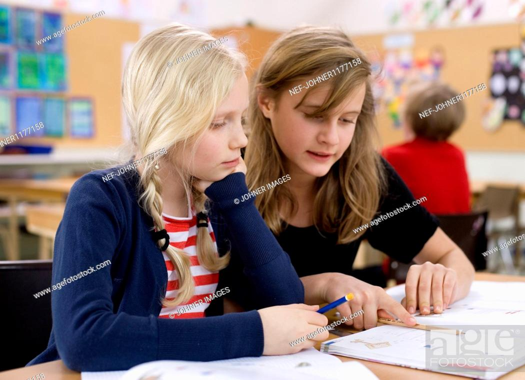 Stock Photo: Two girls studying.