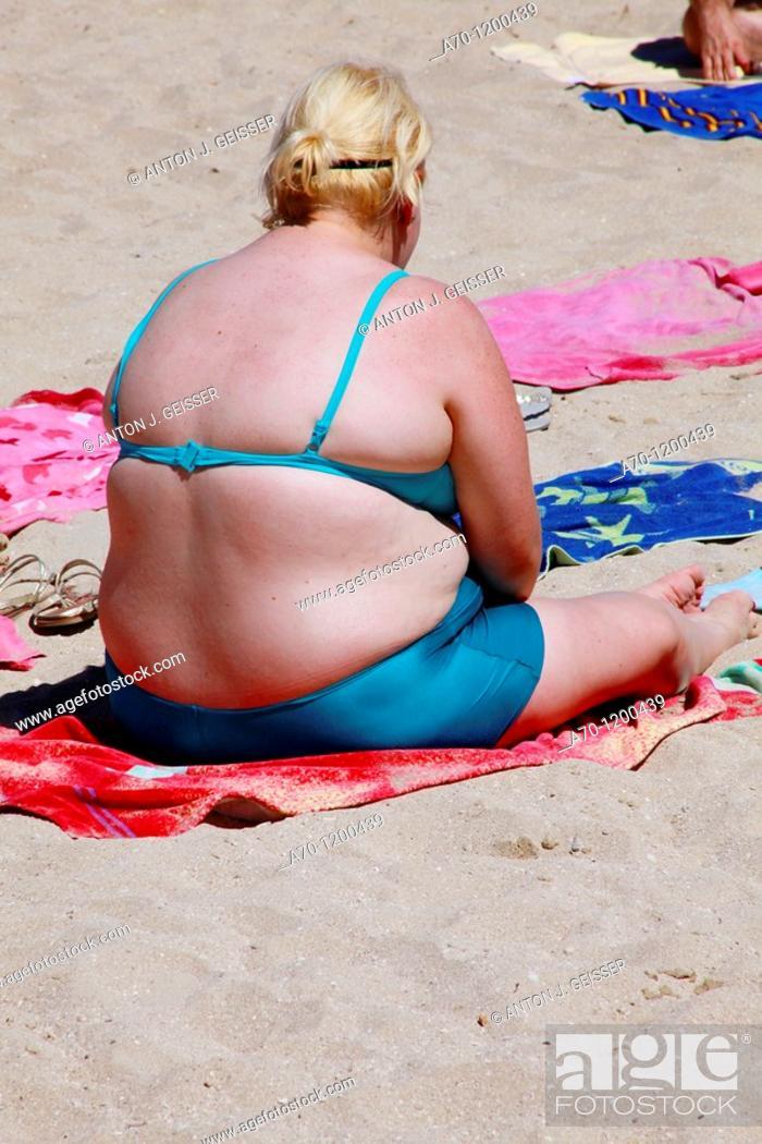 Stock Photo: Overweight young girl at the beach, palma de mallorca.