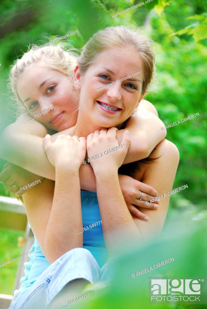 Stock Photo: two teenage girls embracing.