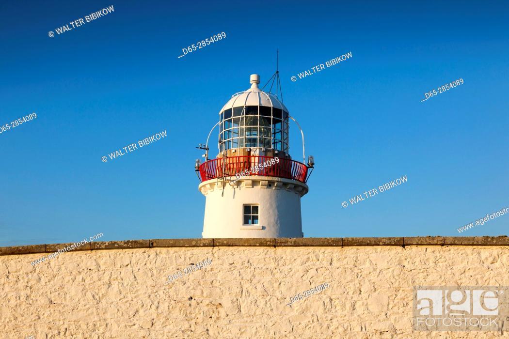 Stock Photo: Ireland, County Donegal, St. John's Point, St. John's Point Lighthouse, dusk.