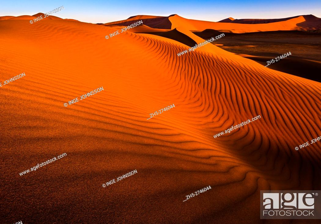 Stock Photo: Sossusvlei is a salt and clay pan surrounded by high red dunes, located in the southern part of the Namib Desert, in the Namib-Naukluft National Park of Namibia.