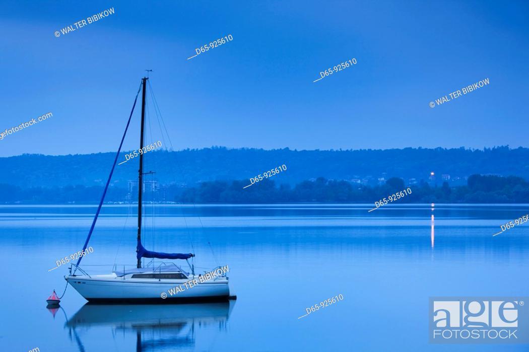 Stock Photo: Italy, Lombardy, Lake Maggiore, Angera, sailboat.