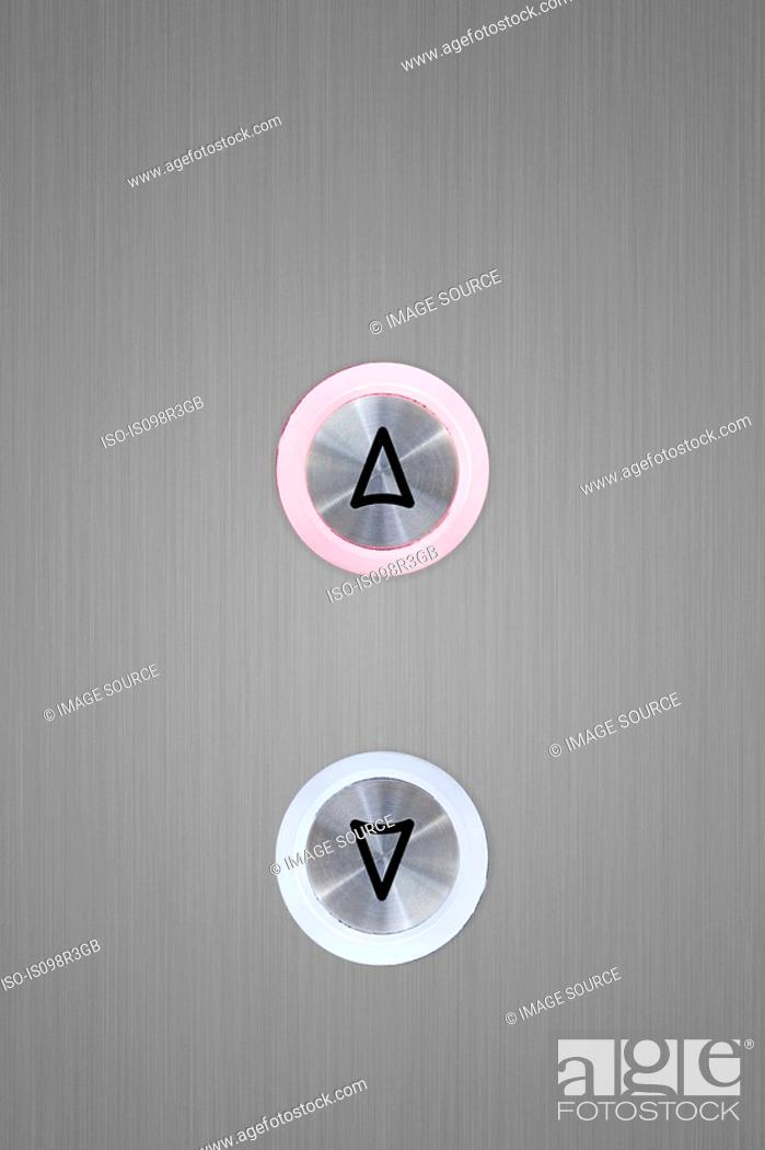 Stock Photo: Up and down elevator buttons with up button lit up.