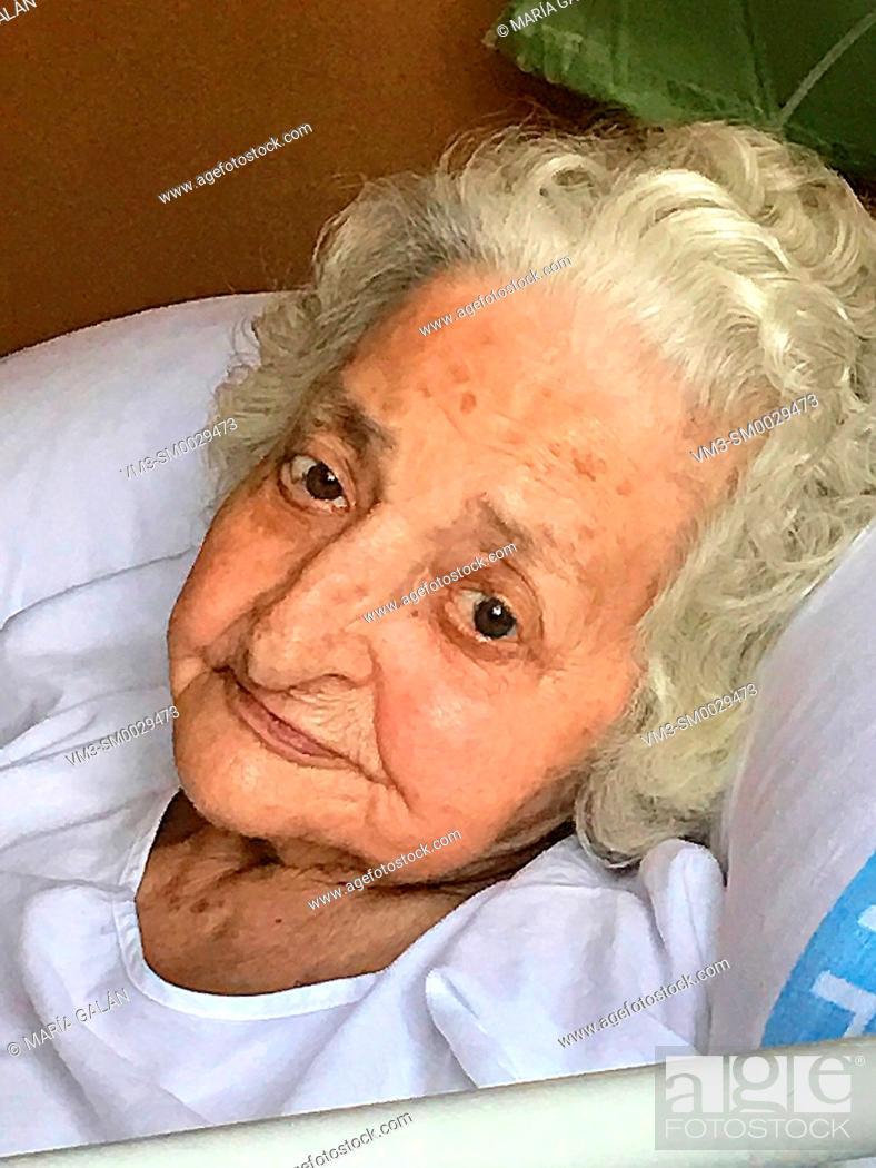 Stock Photo: Old woman at hospital.