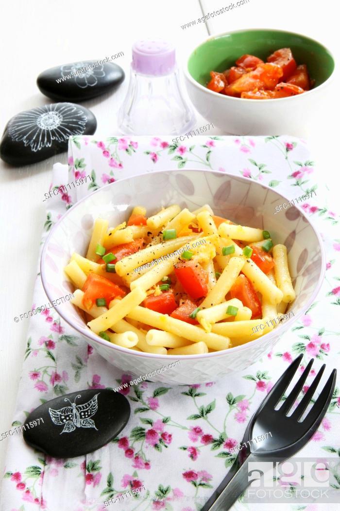 Stock Photo: Rigatoni with raw tomatoes.