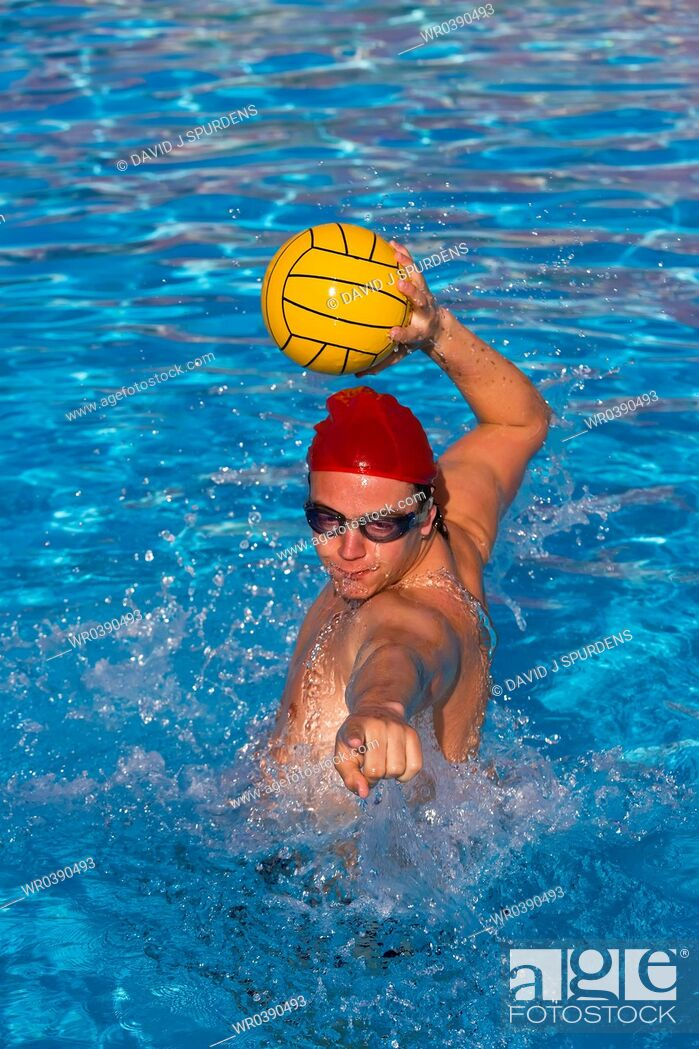 Stock Photo: Water polo player lines up ball for goal.
