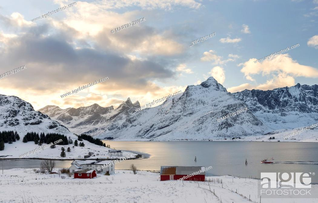 Stock Photo: Entrance to Nesstraumen. Mountains of Moskenesoya rising over Selfjorden and Torsfjorden near village Fredvang, seen from Flakstadoya.