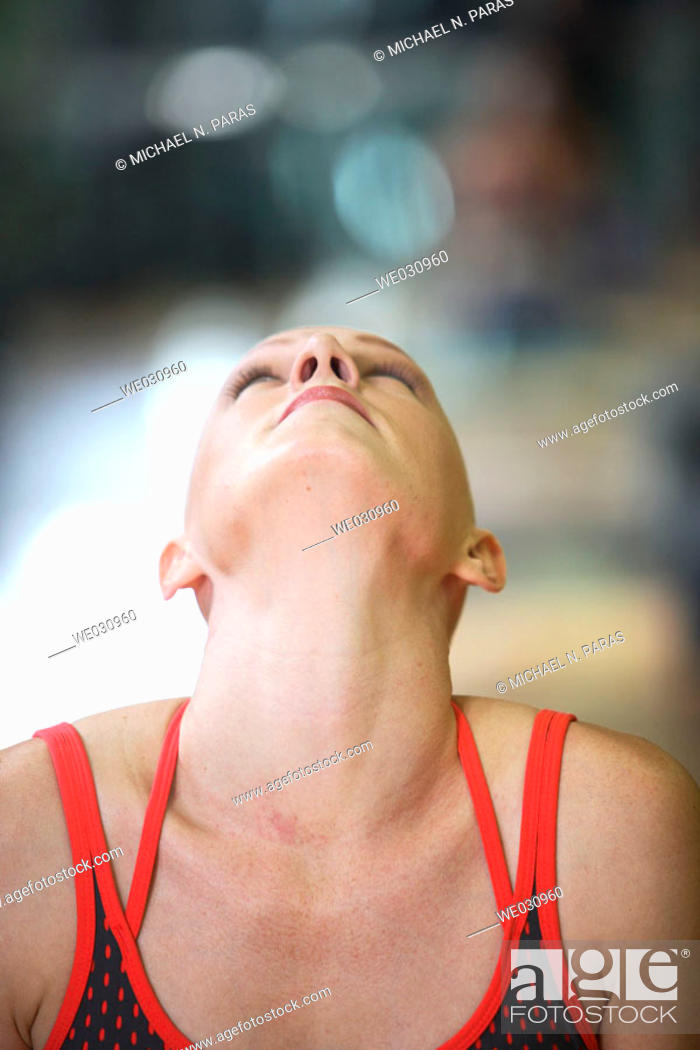 Stock Photo: Caucasian woman with cancer/alopecia areata working out.
