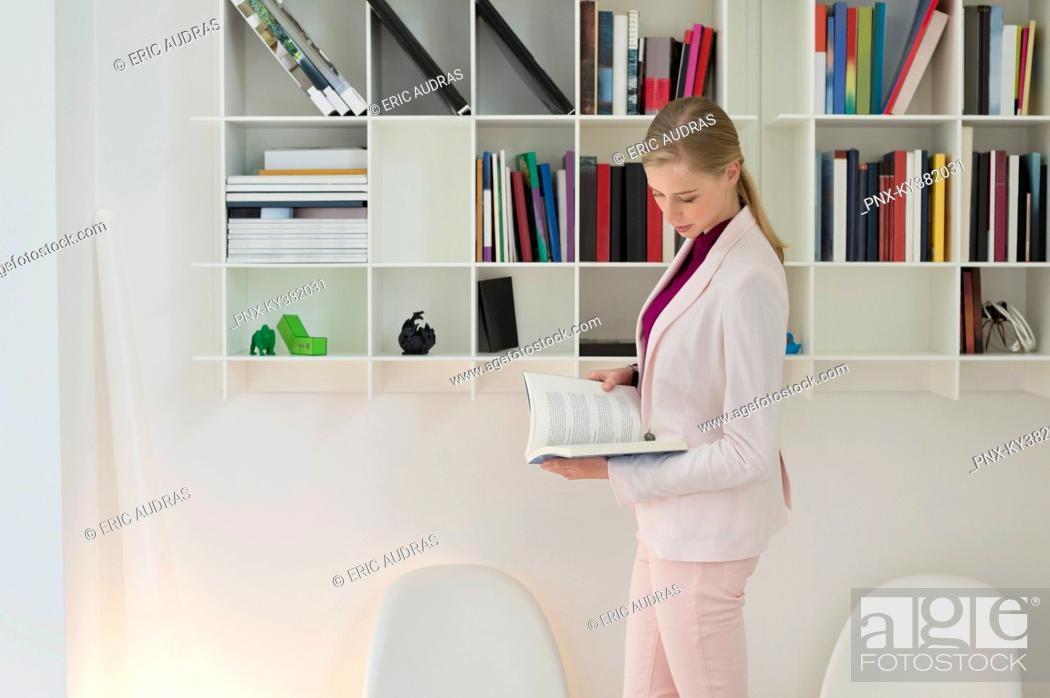 Stock Photo: Businesswoman reading a book.