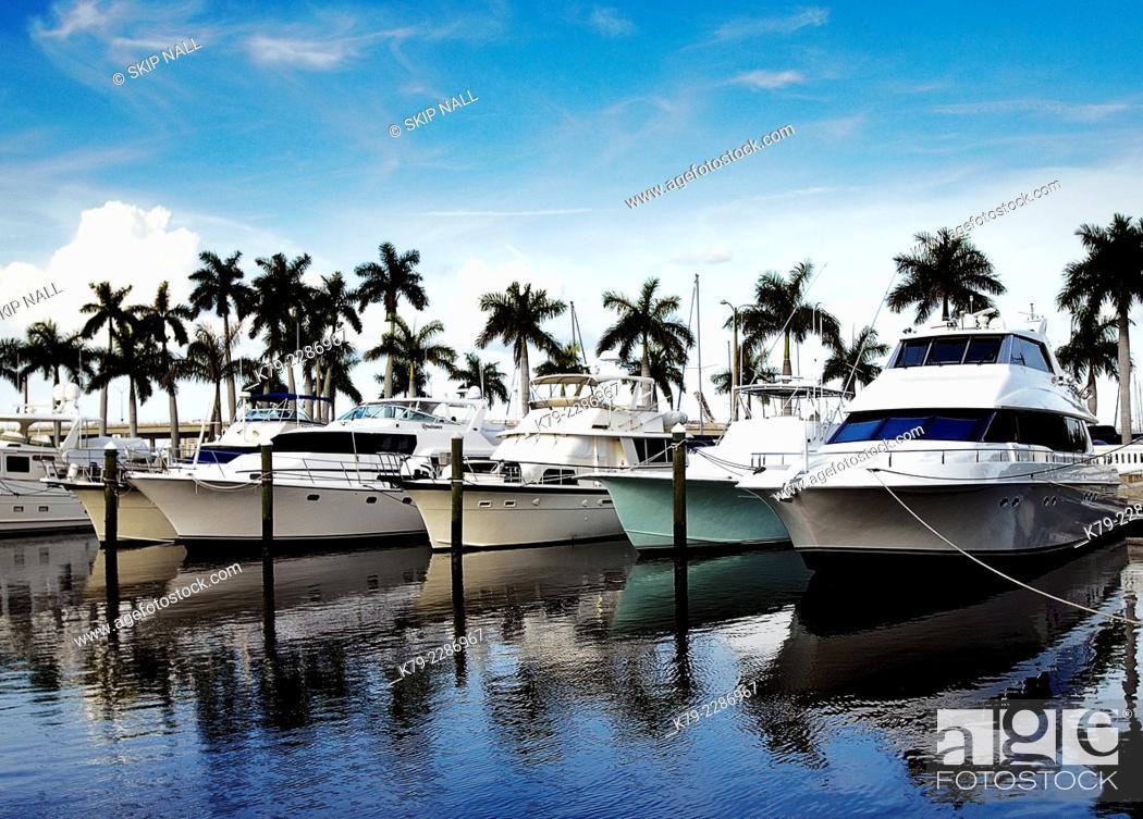 Stock Photo: Luxury boats at a marina in Florida.