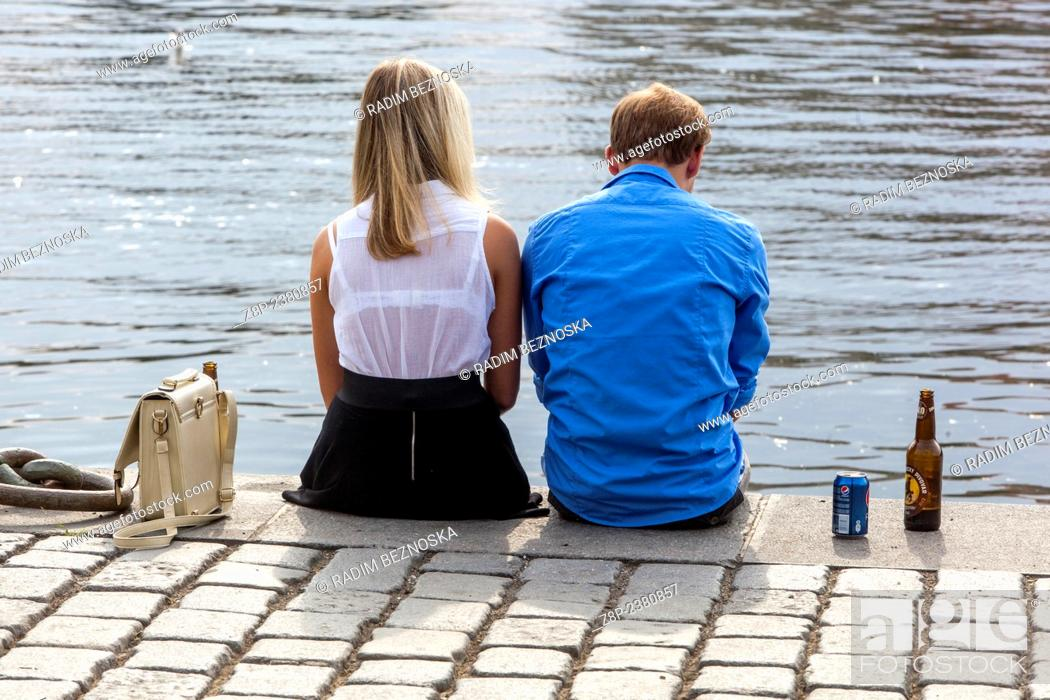 Stock Photo: The pair on the river bank, Prague.