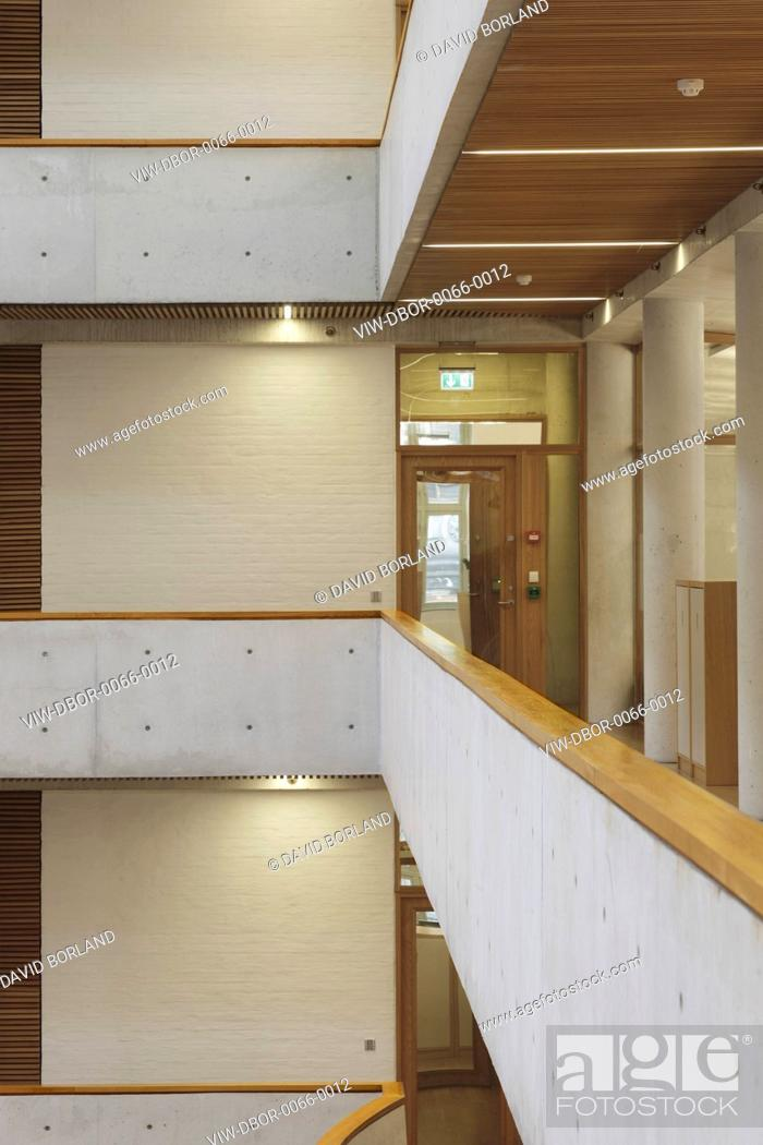 Stock Photo: Gyldendal Headquarters, Oslo, Norway. Architect: Sverre Fehn, 2007. Detail of upper levels of enclosed central courtyard with white painted brick walls.