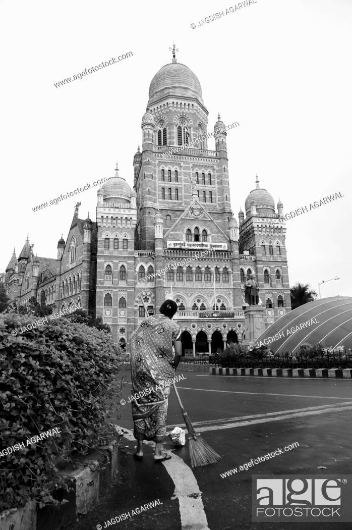 Stock Photo: Woman sweeping road, Bombay Municipal Corporation Building, Mumbai, Maharashtra, India, Asia.