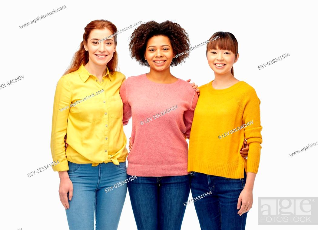 Stock Photo: diversity, race, ethnicity, friendship and people concept - international group of happy smiling women over white.