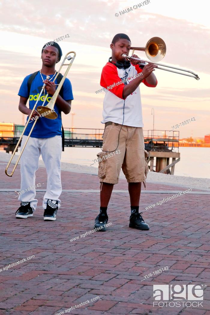 Two young musicians from College jazz band on the waterfront