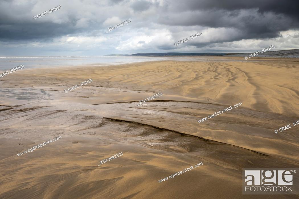 Stock Photo: Patterns left in a sandy beach by the retreating tide at Westward Ho!, North Devon, England.