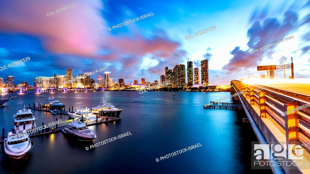 Stock Photo: Boats moored at dock, cityscape in background, Miami, Florida, USA.