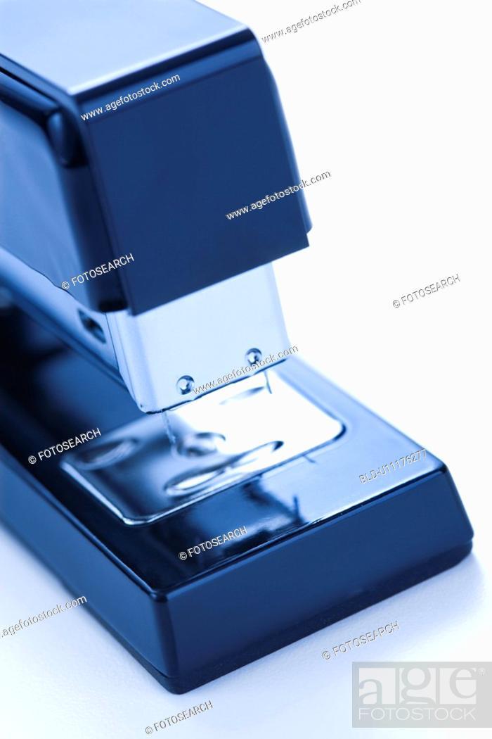 Stock Photo: Close up of blue stapler on white background.