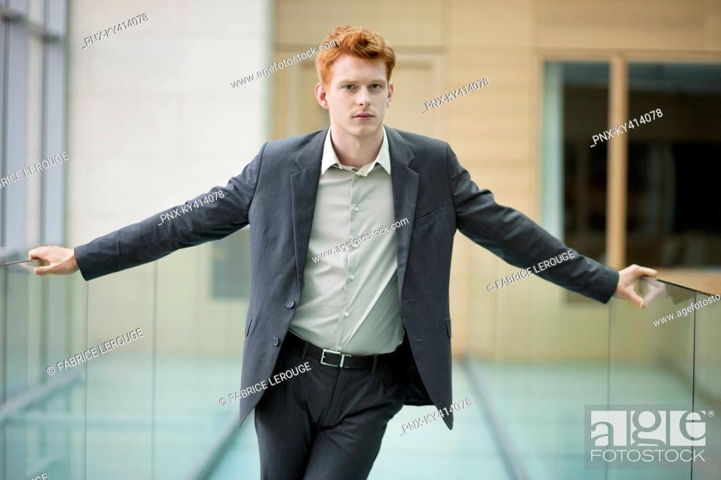 Stock Photo: Portrait of a businessman in an office.