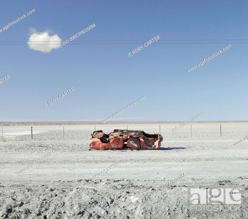 Stock Photo: Abandoned car on dirt road.