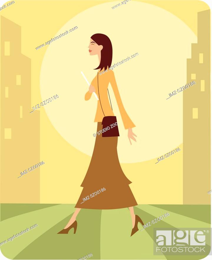 Stock Photo: Woman walking to work in the city.