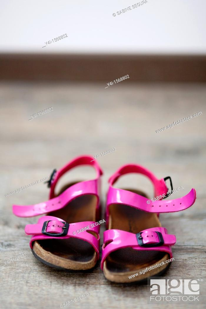 Stock Photo: Pink sandals of a little girl.