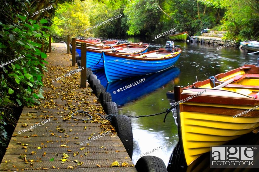 Stock Photo: Rowing boats on a river near Lough Corrib, Galway, Ireland.