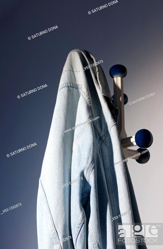 Stock Photo: denim jacket on hook.