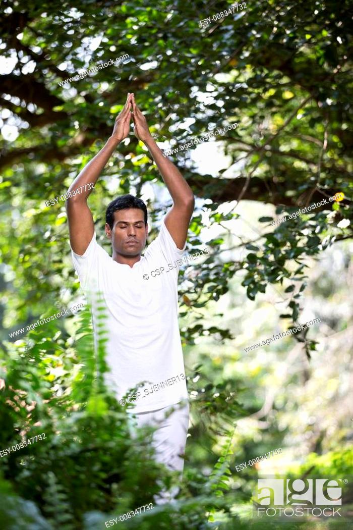 Indian Man Doing Yoga Exercise In A Forest Stock Photo Picture And Low Budget Royalty Free Image Pic Esy 008347732 Agefotostock