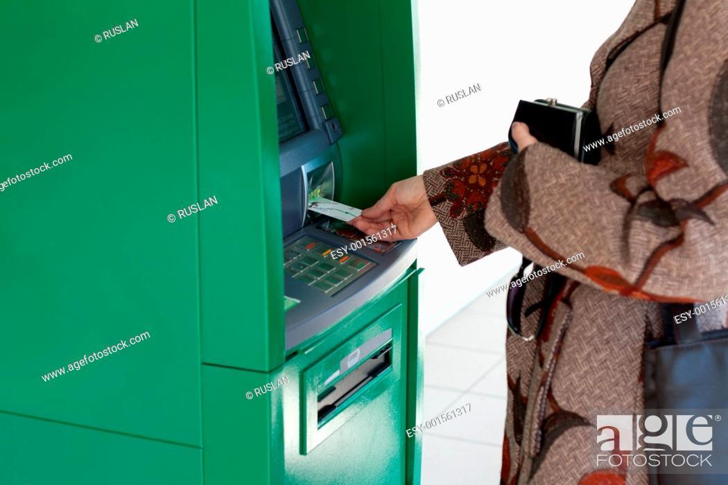 Stock Photo: Girl uses bank terminal.