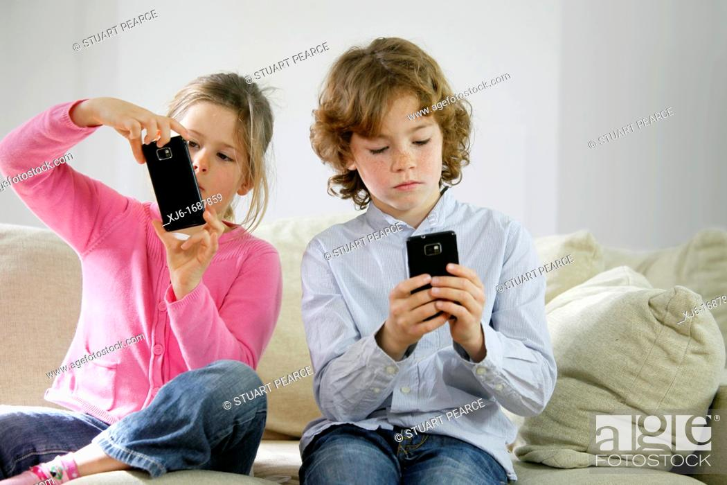 Stock Photo: Children using smartphones.
