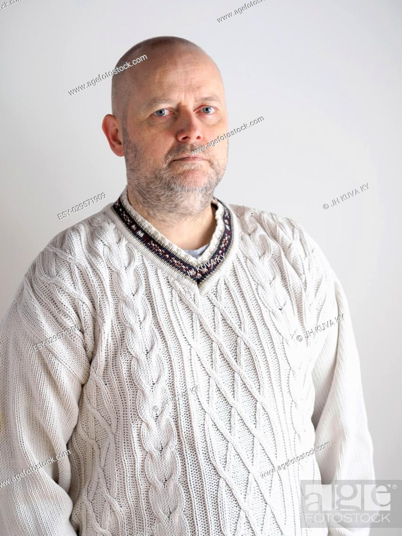 Stock Photo: Portrait, casual looking caucasian male wearing a white pullover, he looks toward the camera.