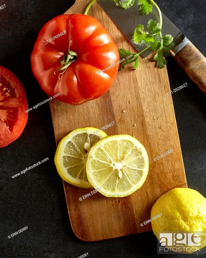 Stock Photo: Tomatoes and lemons.
