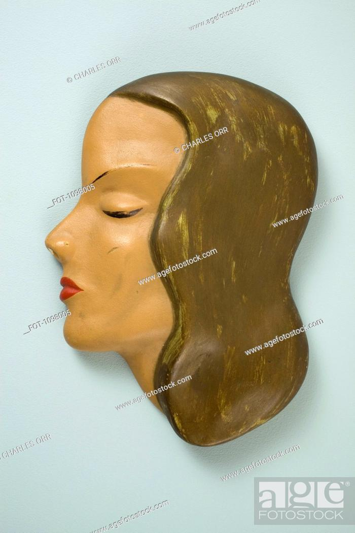 Stock Photo: A retro wall hanging, female mannequin profile.