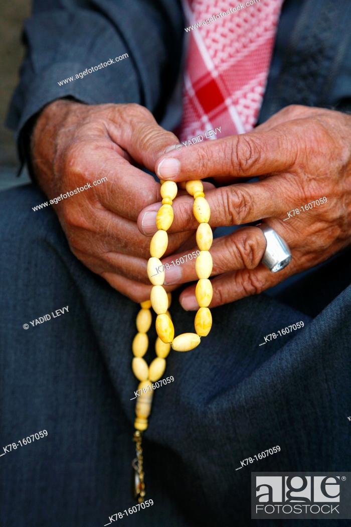Stock Photo: Man holding worry beads, Amman, Jordan.