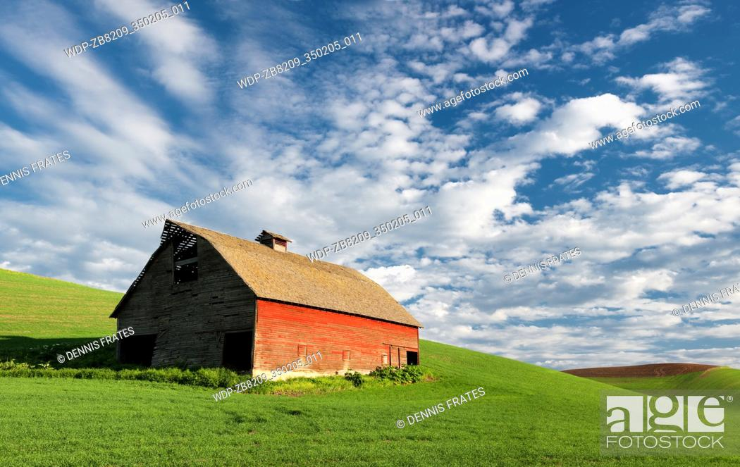Stock Photo: Barn with approaching storm clouds. The Palouse, Washington.