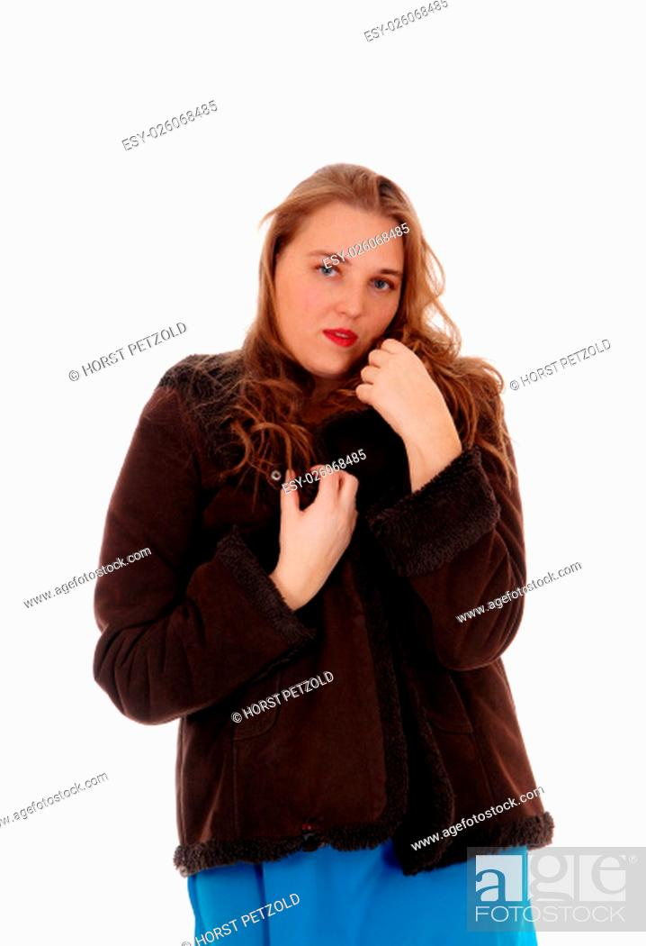 f37e426295381 Stock Photo - A beautiful young woman standing in a brown winter jacket  isolated.for white background