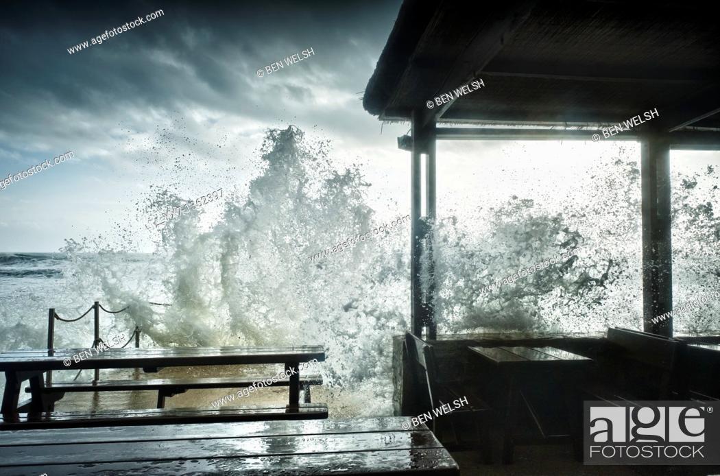 Stock Photo: Waves breaking against bar terrace. Costa de la Luz, Cadiz province, Spain.