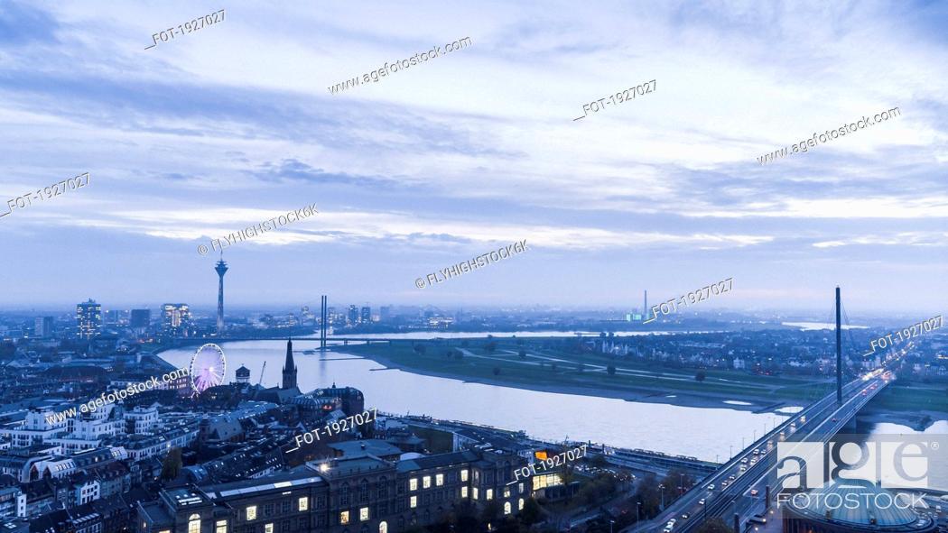 Stock Photo: Rhine River and cityscape at dusk, Duesseldorf, North Rhine-Westphalia, Germany.