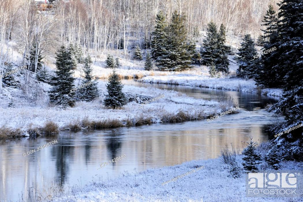 Stock Photo: A dusting of early snow on the shoreline of Junction Creek Greater Sudbury Ontario.