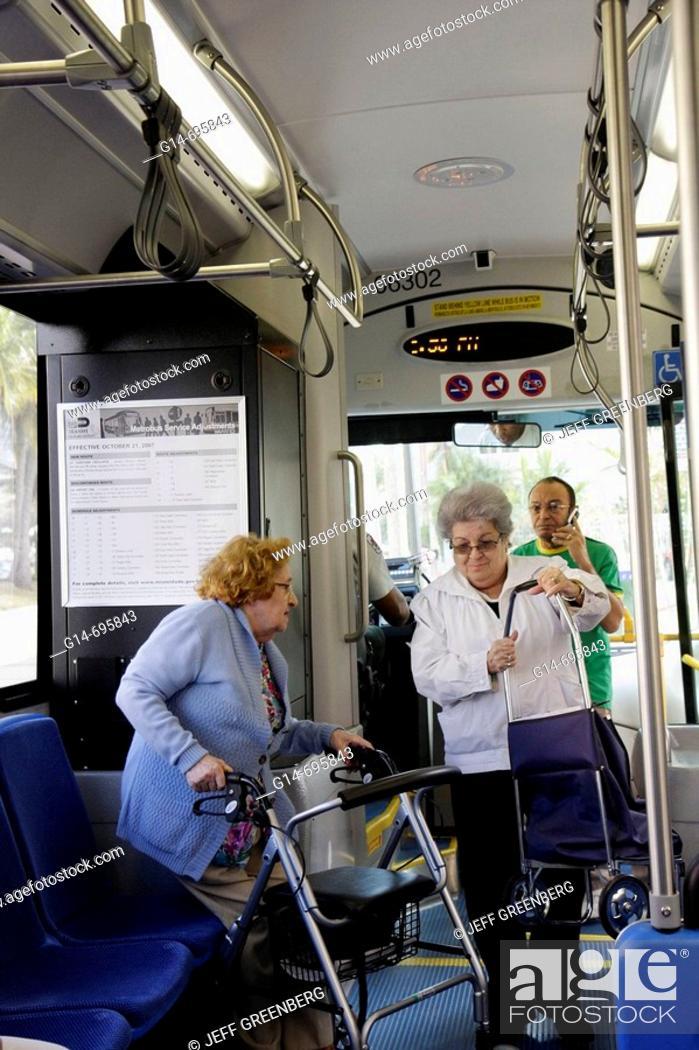 Stock Photo Florida Miami Beach Washington Avenue Metrobus South Local Public Transportation Pengers Hispanic Senior Woman Women
