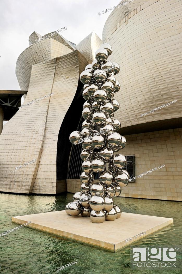 Stock Photo: The big tree and the eye of Anish Kapoor at the Guggenheim Museum, Bilbao.